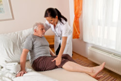 caregiver helping mature man