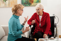 caregiver giving speech therapy